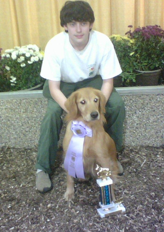 Nate and Breeze with reserve trophy and ribbon at Big E